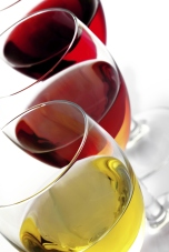 Three glasses of wine on white background